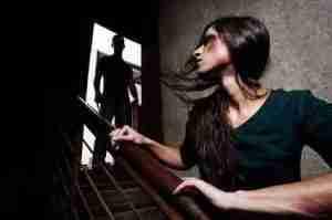 Woman afraid of man.