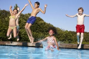 Children jumping in pool