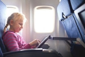 Child traveling on a plane