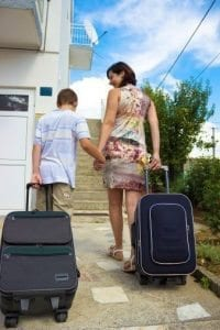 Woman and son leaving with luggage.