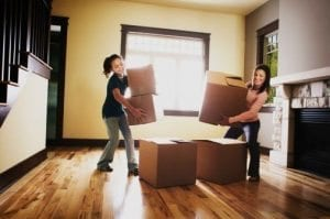 Mother and daughter with moving boxes