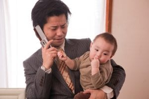 Man holding child and phone