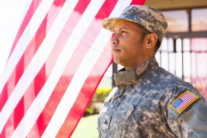 Soldier in front of flag