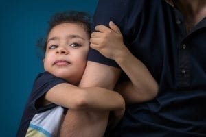 Child holding father's arm