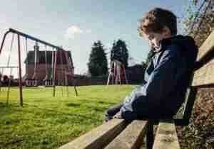 Sad child in park