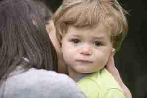 Mother hugging little boy