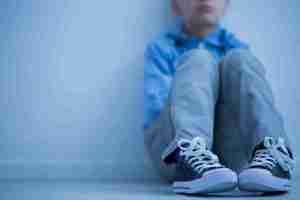 Little boy in corner