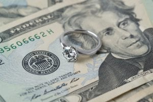 Wedding ring on top of money