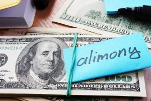 Hundred dollar bills with alimony label