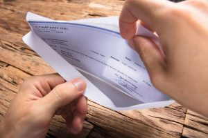 opening paycheck envelop