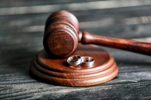 Gavel with wedding rings
