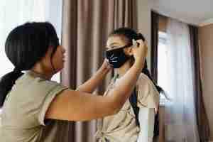 putting mask on child