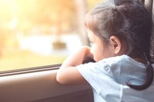 child looking out of car window
